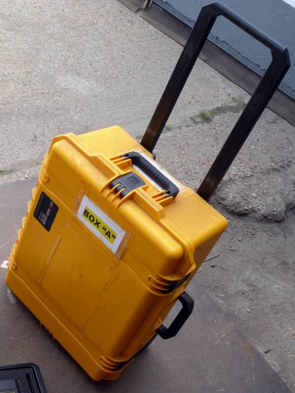 Yellow Peli case on wheels with retractable handle
