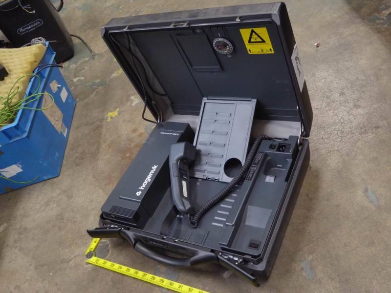 Portable suitcase style satellite phone