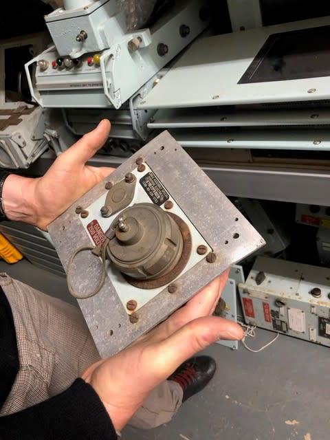 Industrial looking panel with metal screw cap