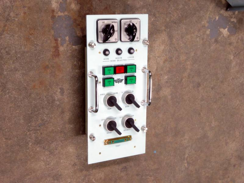 Non-practical navy panel with square coloured buttons & rotary switches
