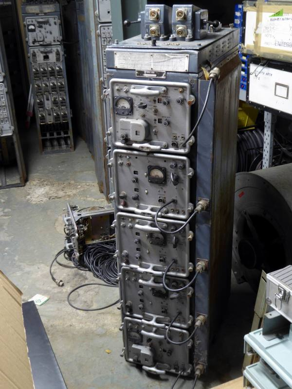 Soviet/Russian radio transmitter rack with pull-out modules & analogue meters