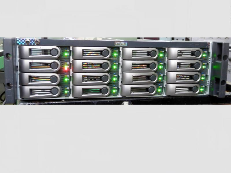 Practical hitech server disk array panel with multiple coloured winking LEDs