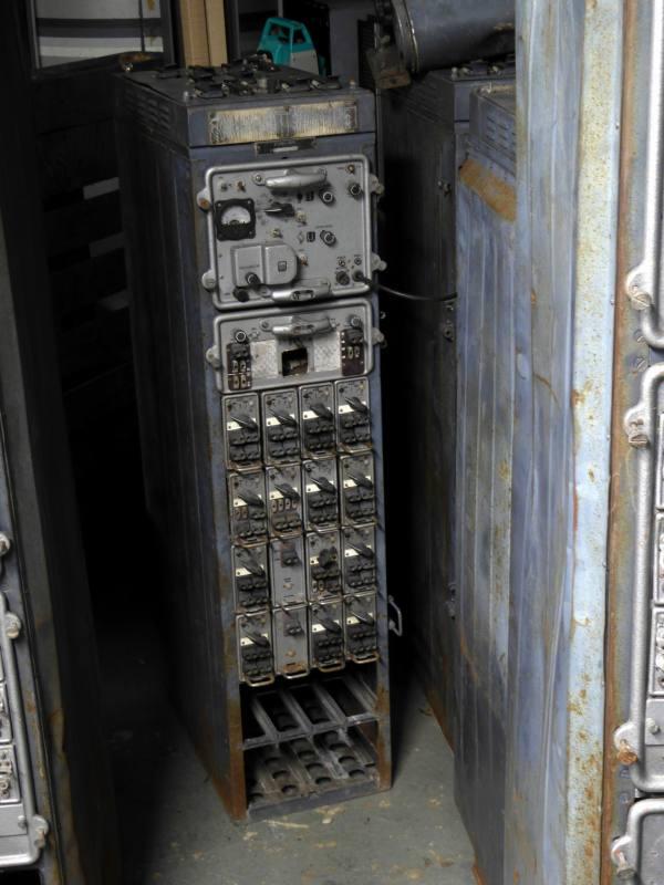 Genuine Soviet/cold war era radio transmitter rack with repeating plugin modules.