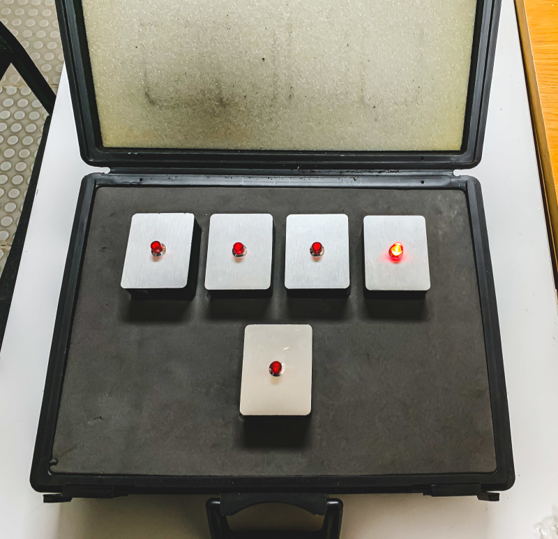 Small bugging devices with red flashing light