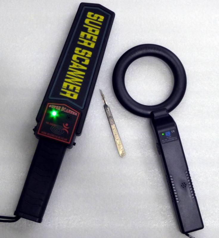 Modern hand held security metal detector wands/racquets