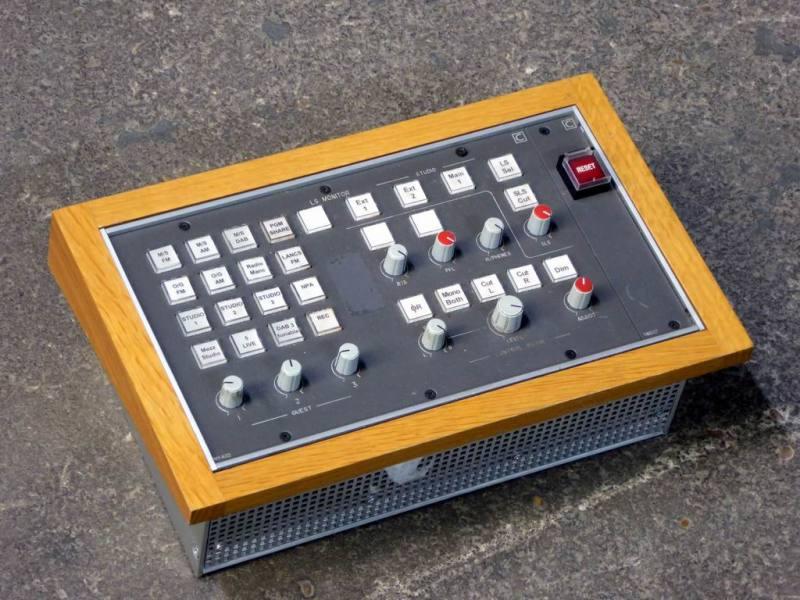 Desktop audio control panels with wooden surrounds