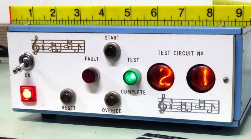 Electronic 1970s test equipment with counting twin nixie number displays.
