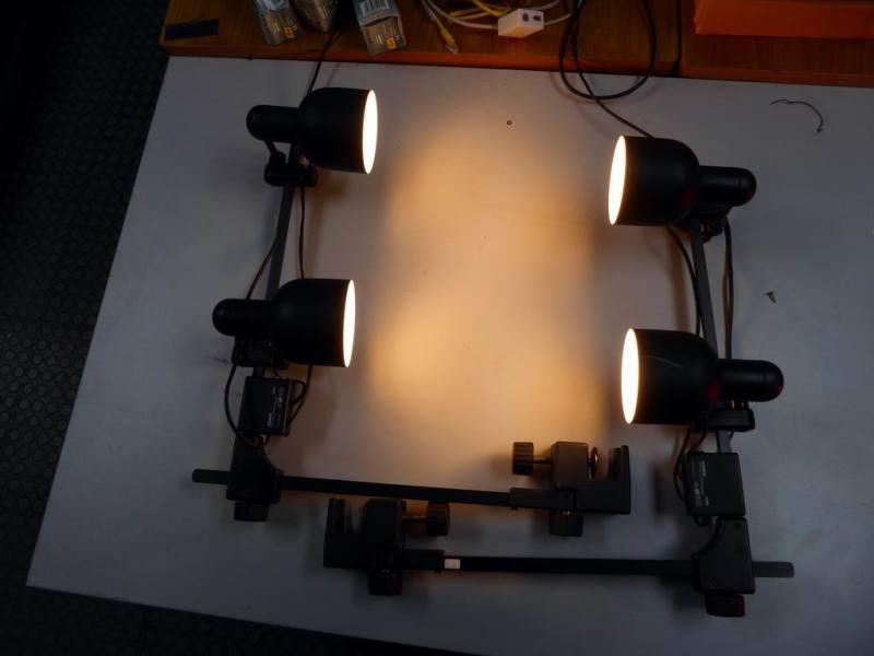 Practical, stylish set of fully adjustable, tulip shaped, table mountable lamps.