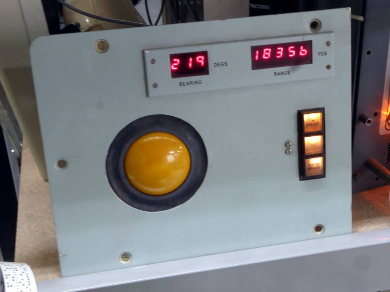 Practical turquoise panel with large yellow trackball & red numeric displays