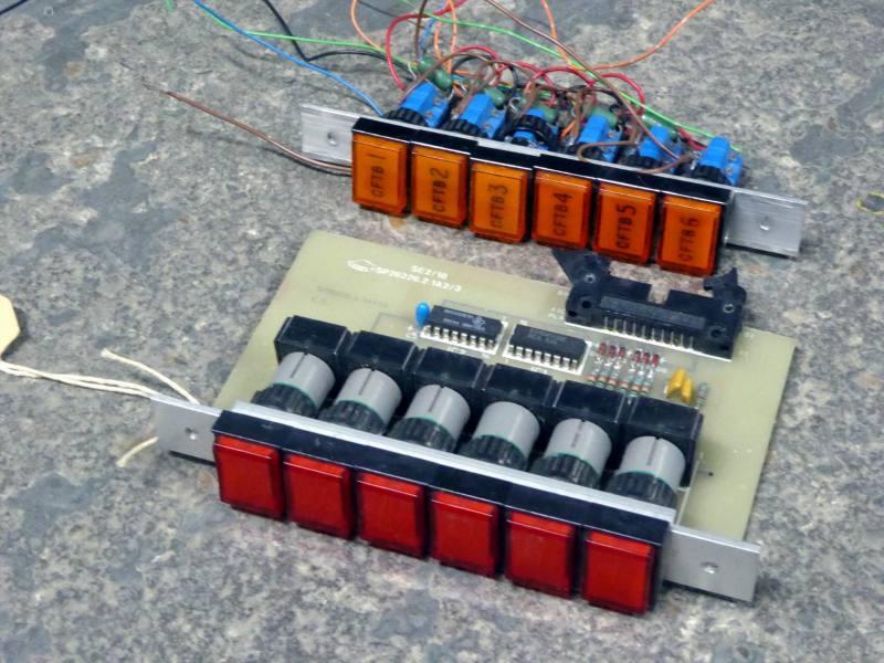 Coloured push button strip assemblies