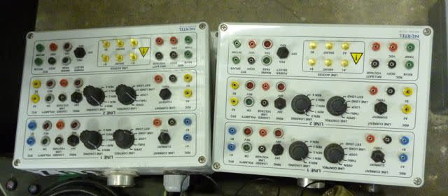 Technical looking boxes with terminals, knobs & LEDs