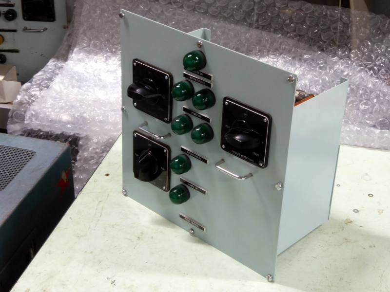 Non practical navy control panel with large domed green lamps & chunky rotary switches