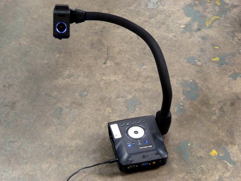 Practical goose neck video camera on stand with tilting illuminator.
