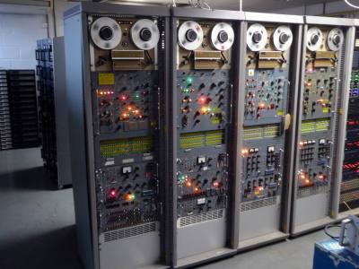 "Practical 6ft 7"" period electronics racks in battleship grey with moving tape spools"
