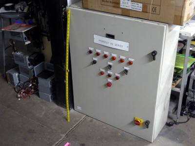 Large electrical box with rotary switches, labelled lamps & master power off switch