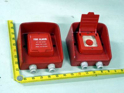 Red fire alarm manual activation switches with flip up covers