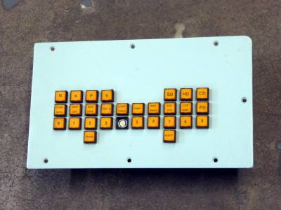 British navy control panel with orange square buttons.