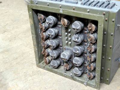 Russian military connector panel with chain-tethered protective covers