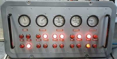 Grey panel with analogue meters and red lights