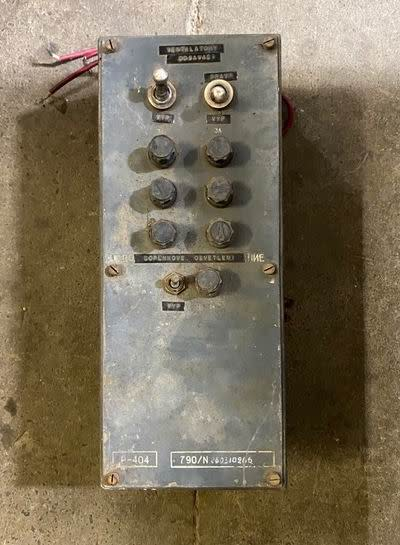 Distressed cold war era electrical switch box in battleship grey