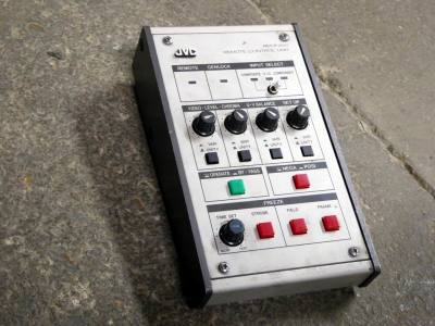 Small desktop console with knobs, switches & buttons for video/audio use