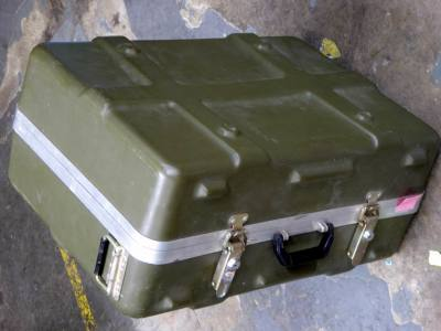 Ruggedised, ribbed khaki plastic flight case with corner wheels