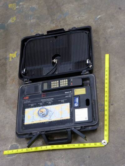 Portable suitcase style satellite phone
