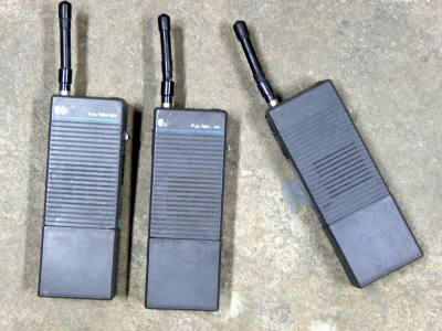 Pye PFX 1980s walkie talkies & charger station