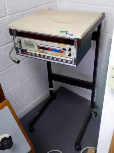 Studio TV/monitor support trolley on wheels with broadcast relevant panels below shelf