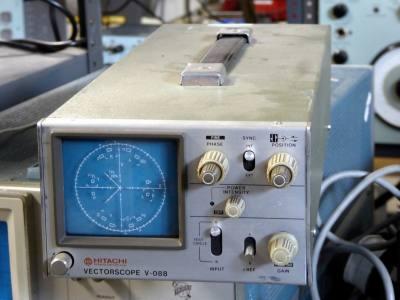 Laboratory vectorscope with blue screen & circular graphic