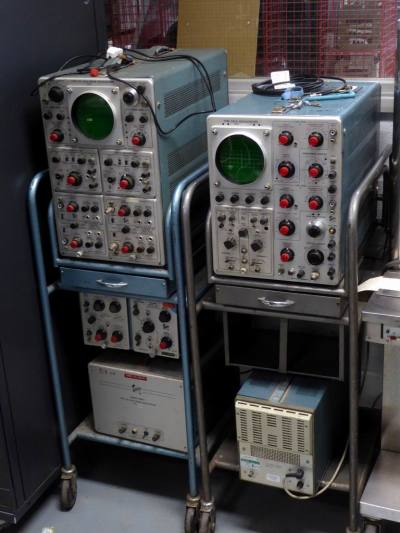 Pair of practical 1950s-1970s Tektronix oscilloscopes on trolleys