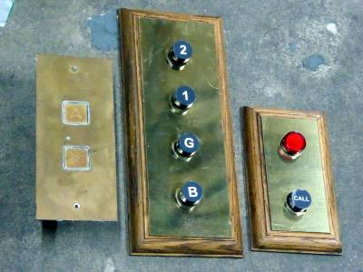 Selection of brass lift control panels