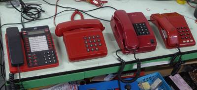 Selection of red desk phones