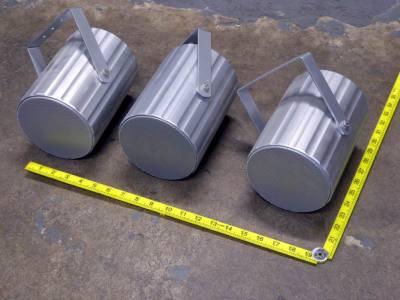Run of stylish, silver tubular wall mount speakers