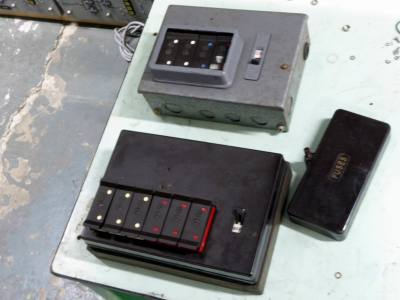 Vintage Brown bakelite & steel fuse boxes with switches