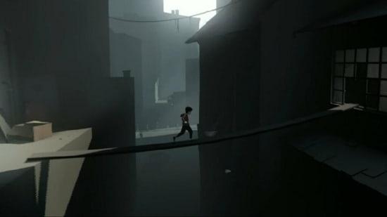 A boy runs across a dangerous plank in a screenshot of Playdead's INSIDE.