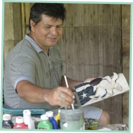 Neftali painting a mask