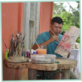 Domingo painting flamingo mask