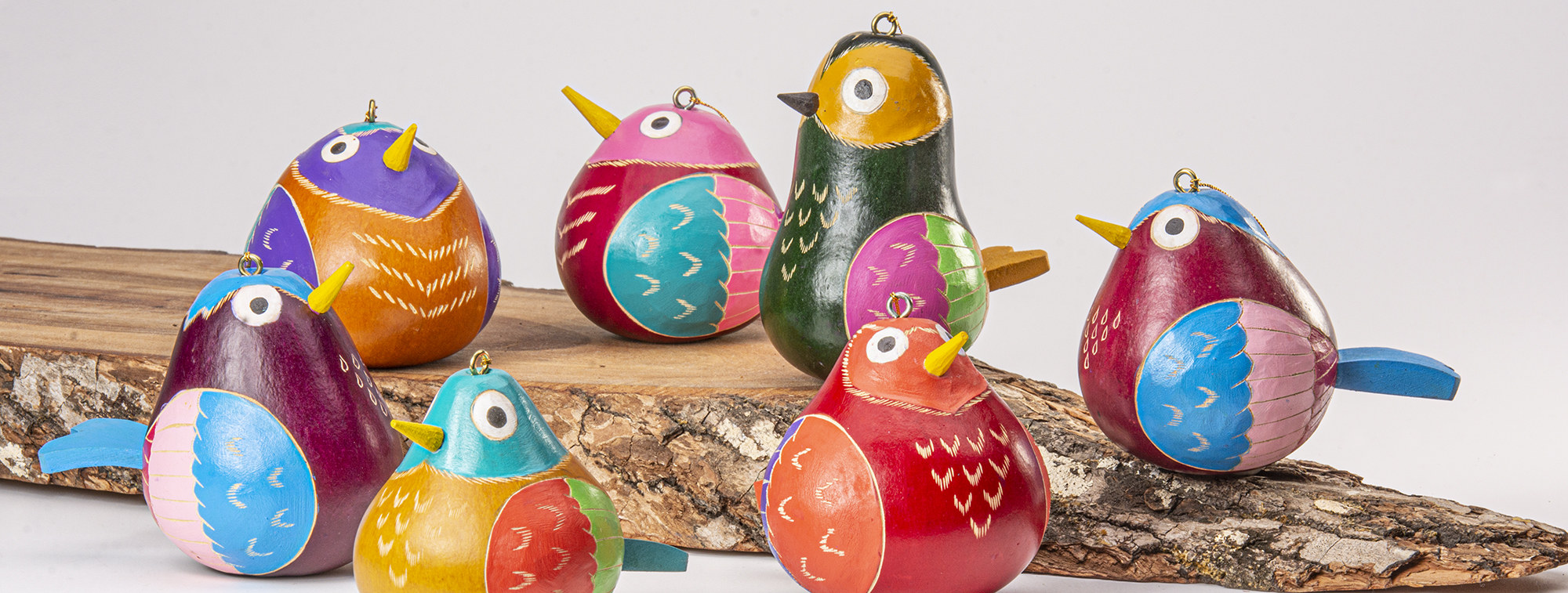 hand-carved and painted birdie ornaments