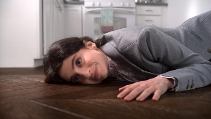 "A ""floor love"" enthusiast like we at LL Flooring hugging new Manhattan Chevron Engineered hardwood flooring."