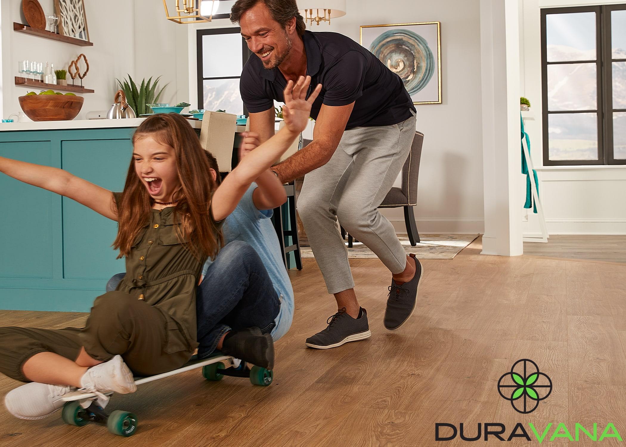 man pushing kids on skateboard in kitchen on Duravana hybrid resilient floors