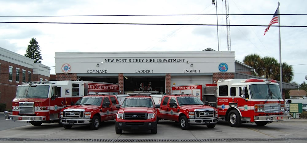 fire and rescue vehicles parked outside a remodeled firehouse showcasing new floors by LL flooring