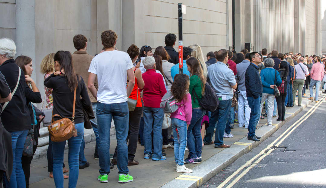 An image of a queue in London representing AWS SQS.