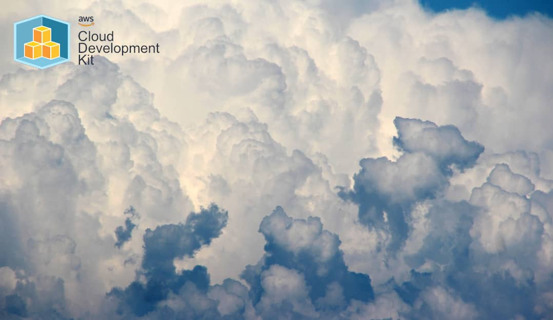 A cloudscape with the AWS CDK logo