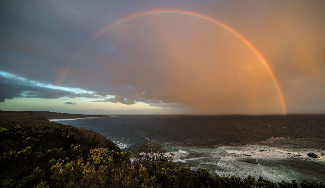 Serverless API with ReactJS - a rainbow over a beach