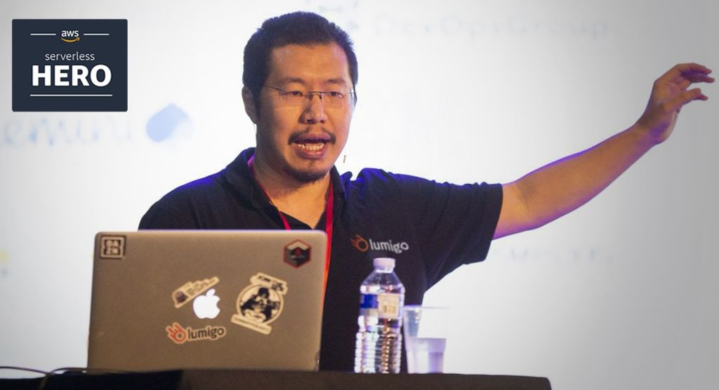 AWS Serverless Hero Yan Cui speaking at a conference