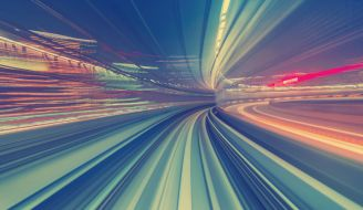 The main image for speeding up serverless development, showing an abstract image of travelling at speed.