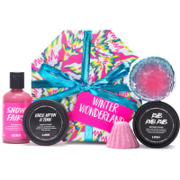 pink white and yellow gift with green ribbon with potted black products and pink shower gel