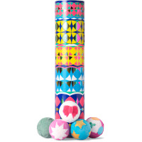 kaleidoscope patterned gift tube with bath bombs around it