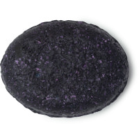 A black oval hair conditioner bar